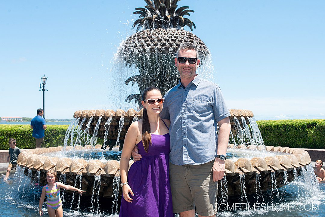 Couple in front of a pineapple fountain in downtown Charleston, which is great for photos.