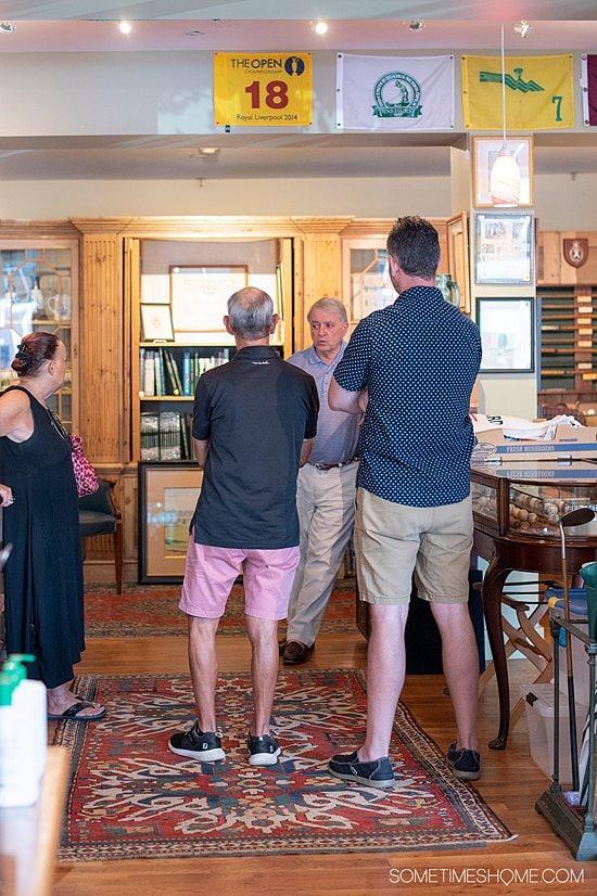 People talking inside the store Old Golf Shop in Pinehurst, NC.