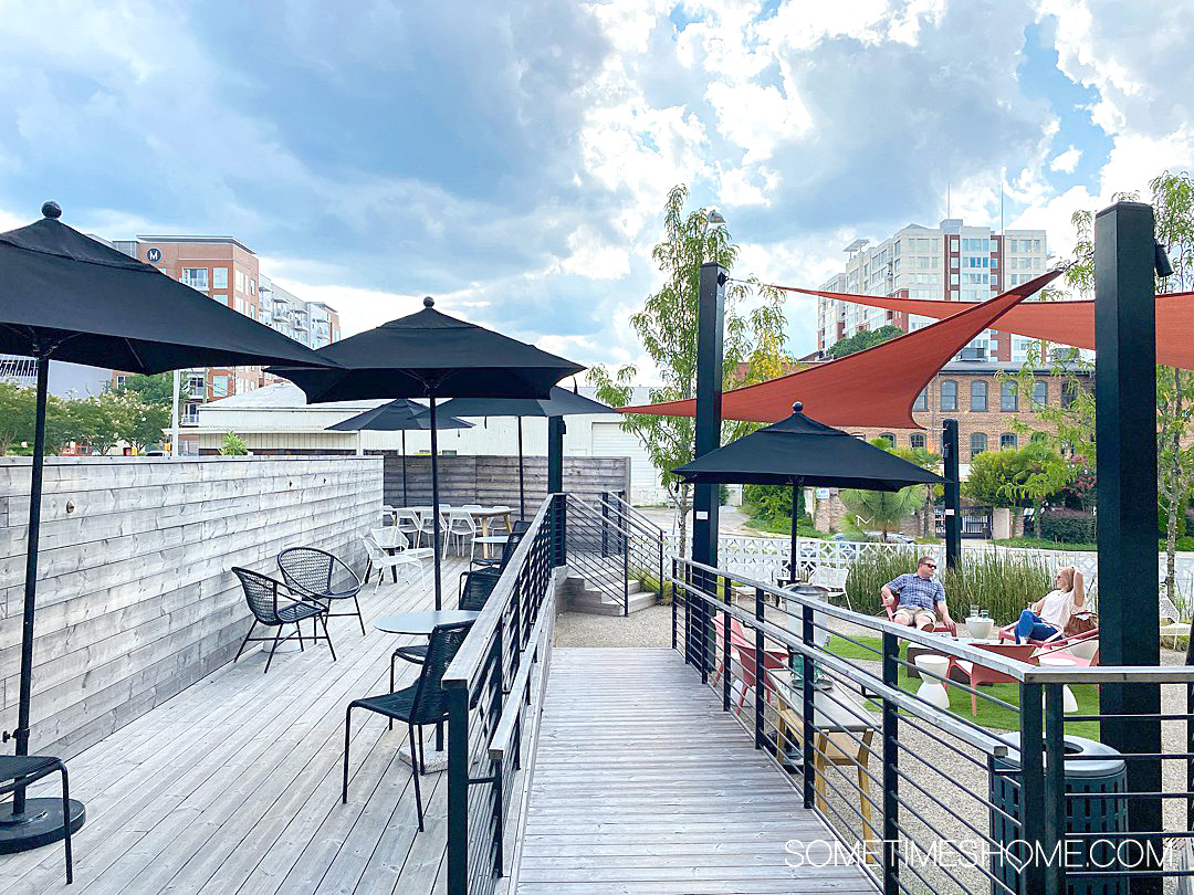 Outdoor seating area on a deck at the Longleaf Hotel in downtown Raleigh